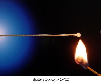 Match lighting a fuse