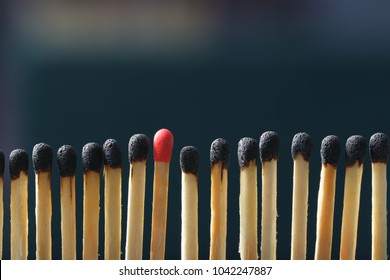 Match standing out from others on dark background. Difference and uniqueness concept