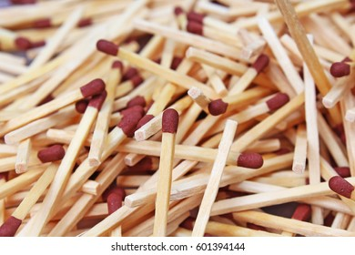 Match sticks with brown heads in a row. Fire Matches texture pattern concept. Stacked matches as background. Combustible inflammable incendiary tindery wooden material.