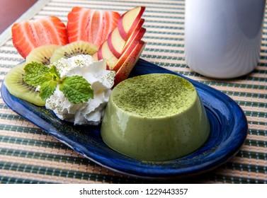 Matcha custard pudding serve with fruits topping.