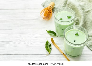 Matcha green latte coffee or tea with leaves