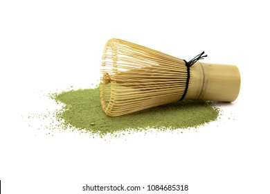 Matcha green tea with bamboo whisk isolated on white background