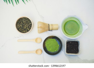 matcha green tea and bamboo whisk on white background. tradition japanese tea ceremonial.