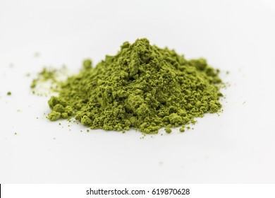 matcha green tea extract powder isolated white background
