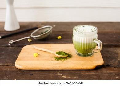 Matcha green tea latte beverage in glass mug  Selective Focus