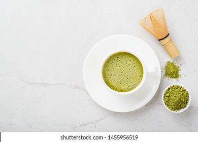 Matcha green tea latte with coconut milk. Top view.