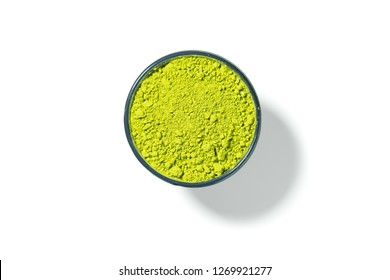 Matcha green tea in round bowl isolated on white background, view directly from above.