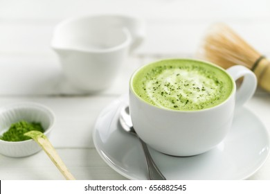 Matcha latte cup close-up background blurred. This latte is a delicious way to enjoy the energy boost & healthy benefits of matcha. Matcha is a powder of green tea leaves packed with antioxidants.