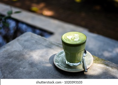 Matcha latte in the garden for add text above.
