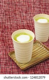 matcha latte in japanese ceramic cups
