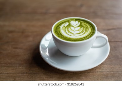 matcha latte on a wooden background
