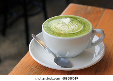 Matcha Latte on wooden table.