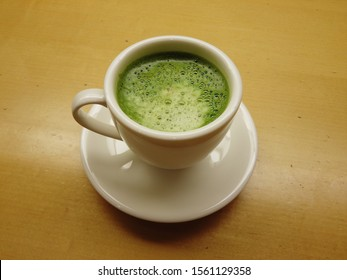 Matcha latte in a white cup