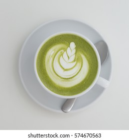 Matcha Latte in White Cup on White Table