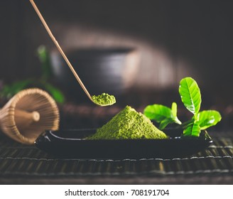Matcha. Organic Green Matcha Tea ceremony. Matcha powder. Cooking with matcha, recipe. Vegetarian healthy drink, beverage, Japanese food. Dark still life.
