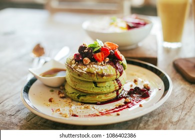 Matcha pancakes with strawberry. Good looked and very tasty. Matcha latte or matcha tea