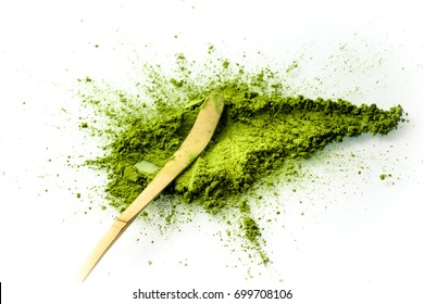 Matcha powder spread with a chashaku spoon overhead view. Matcha is made of finely ground green tea powder. It's very common in japanese culture. Matcha is healthy due to it's high antioxydant count.