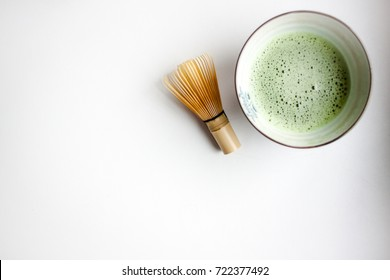 Matcha tea with a bamboo chasen (whisk)