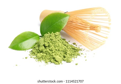 Matcha tea, green leaves and bamboo whisk on white background
