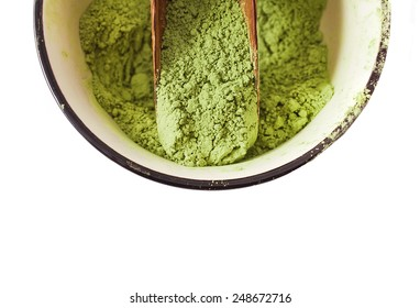 Matcha Tea in the scoop isolated on white background