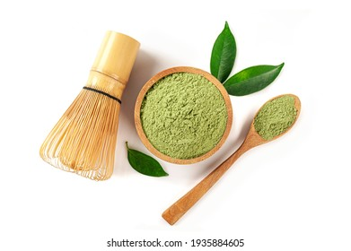 Matcha tea with spoon and leaves isolated on white background. top view