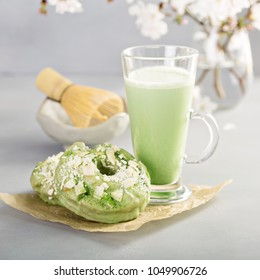 Matcha and white chocolate donuts with matcha tea latte