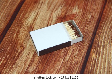 Matchbox with matches on the wooden background with copy space