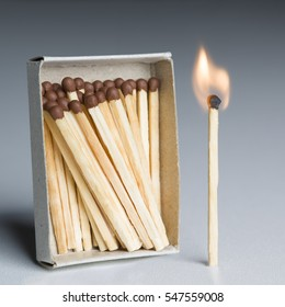 Matches Box and One Match In Fire, Matchstick Burning Flame as Innovation Idea, Team Leader Concept