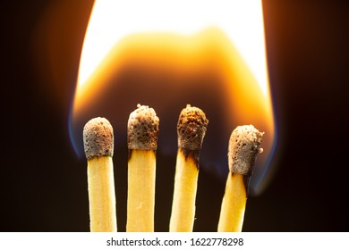 Matches are in flames. Closeup with black Background