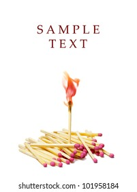 A lot of matches on white isolated background. A match is lit.