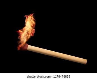 Matchstick burning on black background