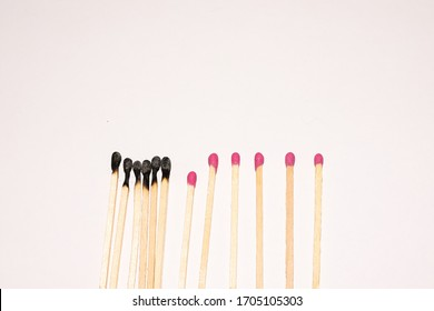 Matchsticks fire burn on a bright  background. The concept of how to stop coronavirus from spreading, social distancing and staying at home. Medical risk management concept.