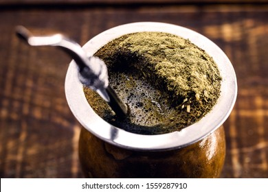 Chimarrão, or mate, is a beverage characterized by South American culture. Typical Brazilian drink, served hot and frothing. Tasty traditional drink from Rio Grande do Sul state. Gaucho symbol.