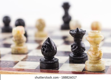 Mate to a white king chess piece by black queen and bishop