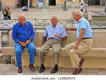 MATERA BASILICATA ITALY 29.08.2015. three old men on the streets of the old town in Vittorio Veneto Square