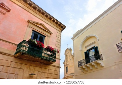 MATERA, Basilicata ITALY Architectural feature of the lateral facade of historical buildings and church of purgatory against blue sky.