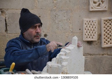 MATERA, BASILICATA, ITALY - DECEMBER 29 - A local artist works on a stone carving inside the ancient town of Matera (Sassi di Matera), European Capital of Culture 2019 on december 29, 2018