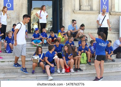 MATERA, BASILICATA, ITALY - July 11, 2019. Group of school pupils and teachers are on excursion tour and visit the  old Sassi town with pre historic cave house buildings. Cultural Capital of Europe