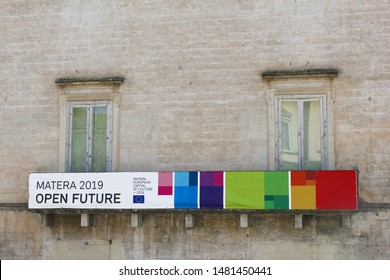 MATERA, BASILICATA, ITALY - July 11, 2019. Banner of European Capital of Culture 2019 with European flag and text Open Future on old building in pre historic town street and ancient neighborhood.