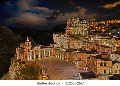 Matera, Basilicata, Italy: landscape at dusk of the old town with the church of Saints Peter and Paul and he rock church Santa Maria de Idris
