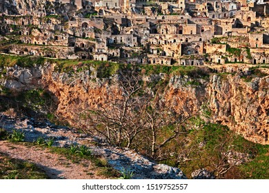 Matera, Basilicata, Italy: landscape  of the old town (sassi di Matera) with the houses carved into the tufa rock over the deep ravine