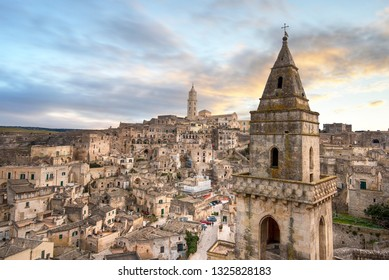 Matera, Basilicata, Italy, landscape at sunset of the old town (sassi di Matera), European Capital of Culture 2019. Church San Pietro Barisano and duomo cathedral. Unesco World Heritage site