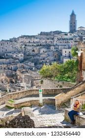 Matera, Basilicata / Italy - October 26 2018: Panoramic beautiful view of Sassi or stones of Matera, European capital of culture 2019, Basilicata, Italy with tourist drawing