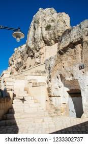Matera, Basilicata / Italy - October 26 2018: Old stairs among rocks of Sassi or stones of Matera European capital of culture 2019, Basilicata, Italy, vertical