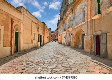 "Matera, Basilicata, Italy: picturesque view of an ancient street in the old town ""Sassi di Matera"", European Capital of Culture 2019"