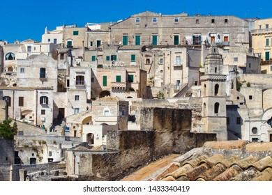 Matera, Basilicata/ Italy - september 01  2013: View of the ancient stone houses of Matera city, illuminated by the sun,  southern Italy, unesco heritage and   european capital of culture 2019.