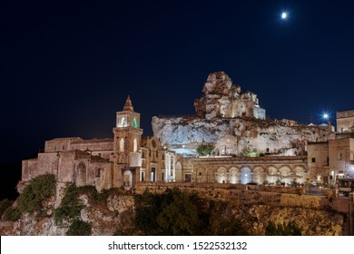 MATERA, BASILICATA, ITALY - September 7 , 2019.Night view at Church of San Pietro caveoso and on the top of the hill of Church of Saint Mary of Idris