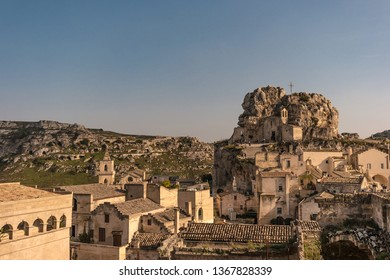Matera, Basilicata, Italy: view at sunset towards the old town (sassi di Matera) with the rock church Santa Maria de Idris, European Capital of Culture 2019