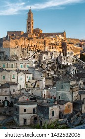 Matera, Basilicata/Italy - august 31 2013: View of the Sasso Baritano with the famous Matera Cathedral of Maria Santissima della Bruna, illuminated by the sunset light.