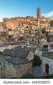 Matera, Basilicata/Italy - august 31 2013: View of the Sasso Baritano with the ancient stone houses and the tower of  Matera Cathedral of Maria Santissima della Bruna.